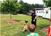 Officer and Canine, Brisco, Perform Training Exercise at Safety Saturday in 2014