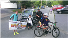 Officer and Children at Walk to School Event in 2014