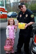 Police Department Officer Holding Easter Eggs With Little Girl Holding Basket