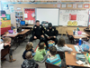 Two Police Officers Read to Kids in Classroom
